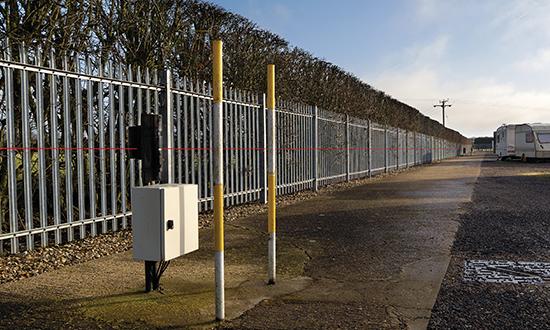 2 metre perimeter steel palisade fencing with Infrared beam alarms.
